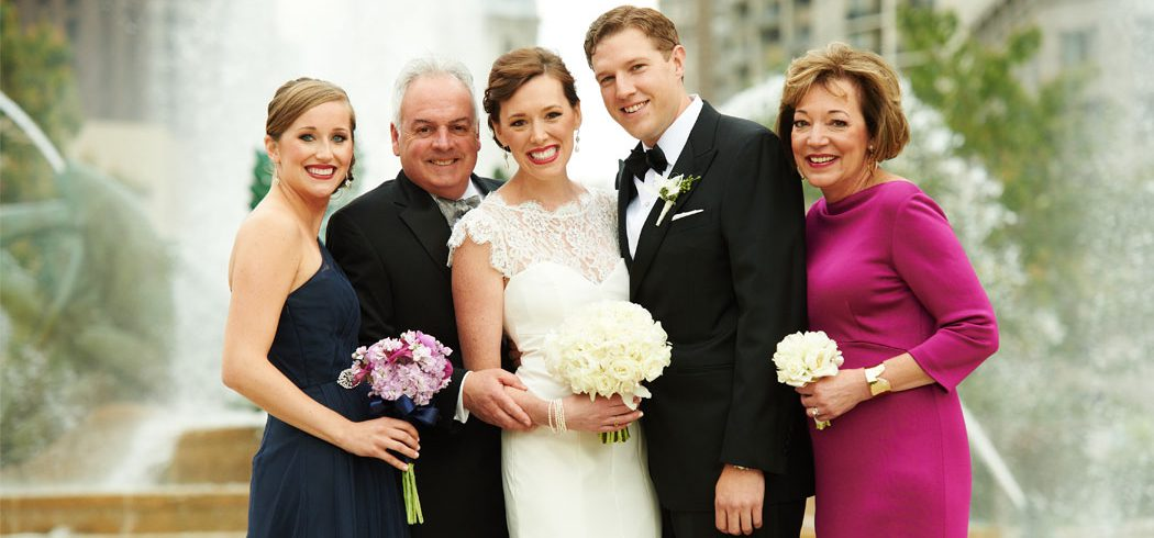 Bride and Groom with Family in Wedding portrait outside at Logan Square in Philadelphia, PA - Event Planning
