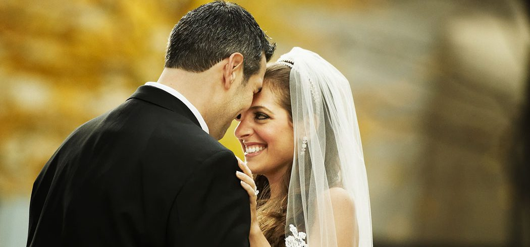 Bride and Groom laugh during outside wedding portraits in Philadelphia, PA - Event Planner