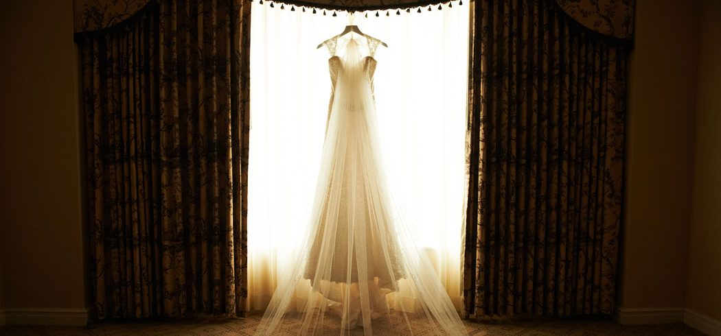Wedding dress in window in Philadelphia, PA - Event Planner