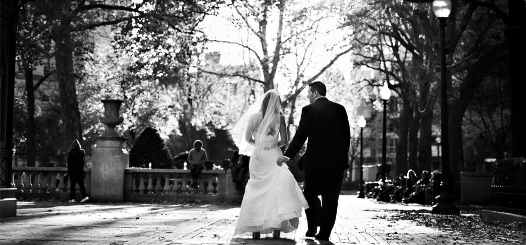 Bride and Groom walk away during outside wedding portraits in Philadelphia, PA - Event Planner