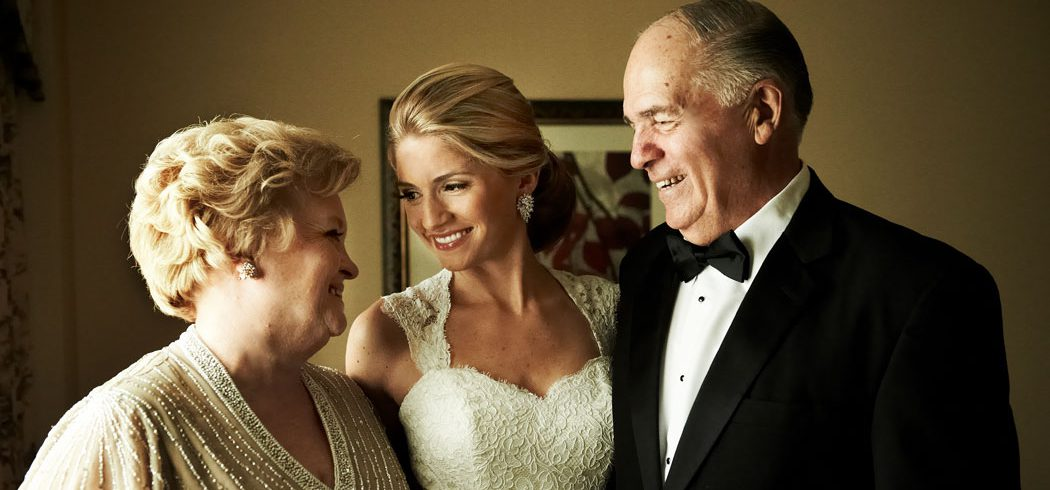 Bride smiling with parents while getting ready for wedding day in Philadelphia, PA - Event Planner