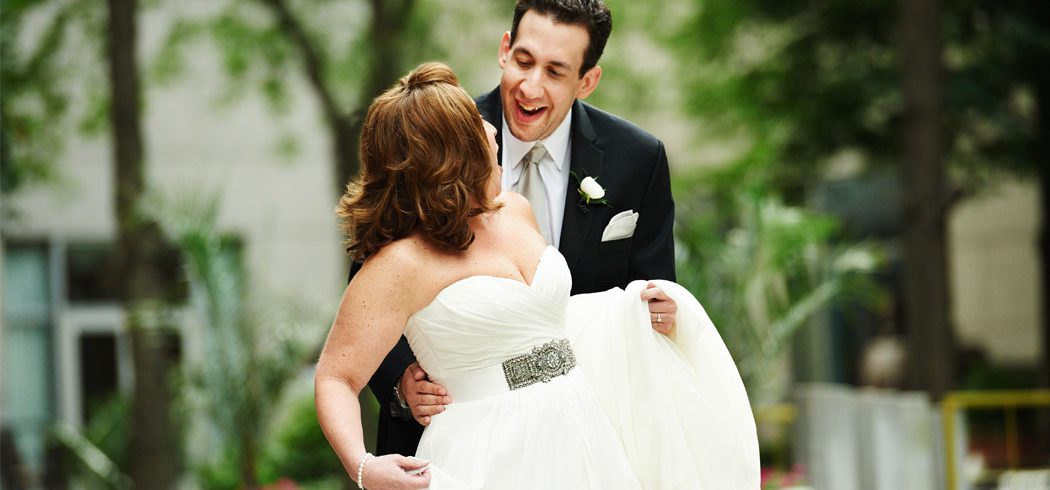 Bride and Groom smiling during first look outside wedding portraits in Philadelphia, PA - Event Planner