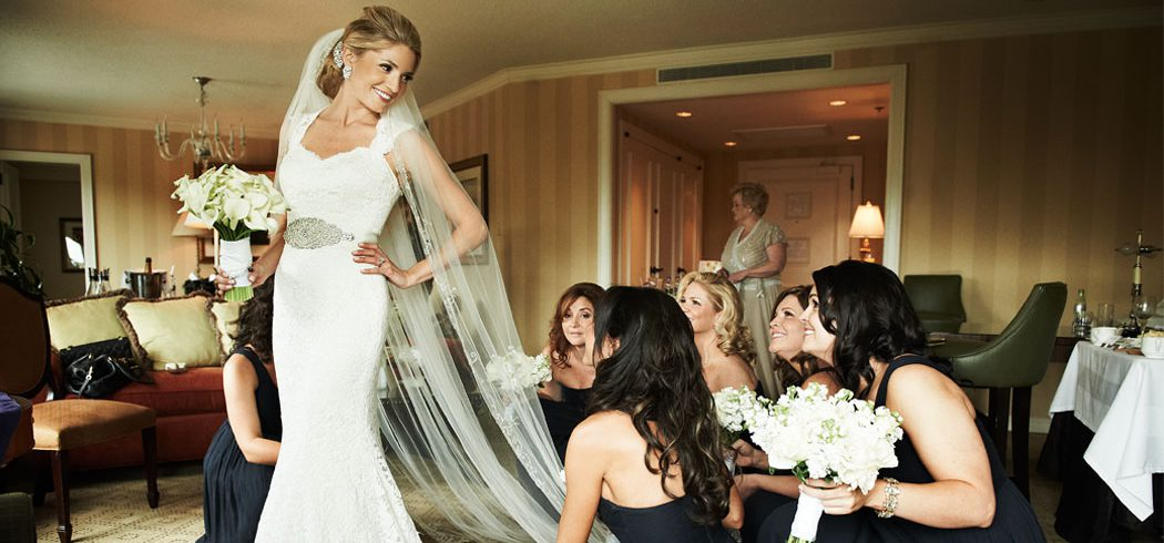 Bride with Bridesmaids putting on Wedding dress and veil in Philadelphia, PA - Event Planning
