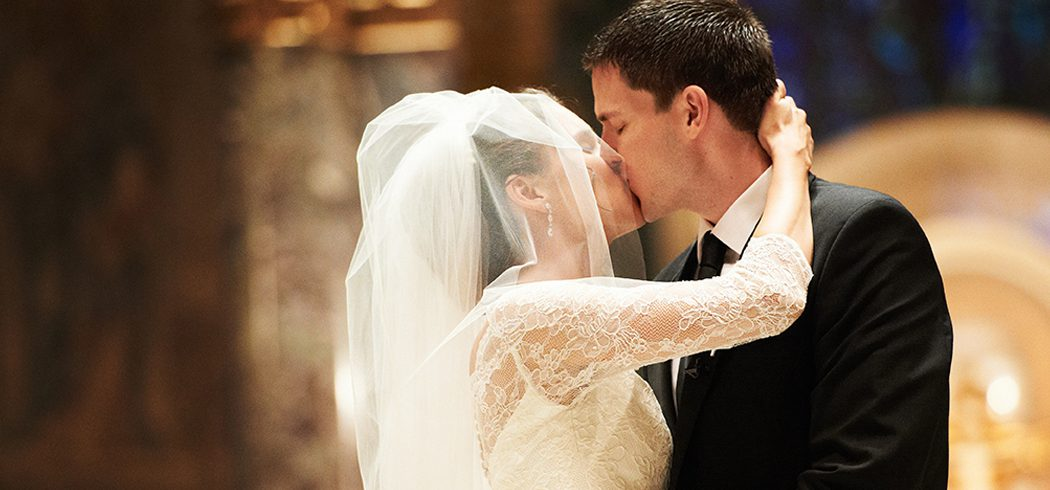 Bride and Groom kiss at wedding ceremony in Church in Philadelphia, PA - Event Planning