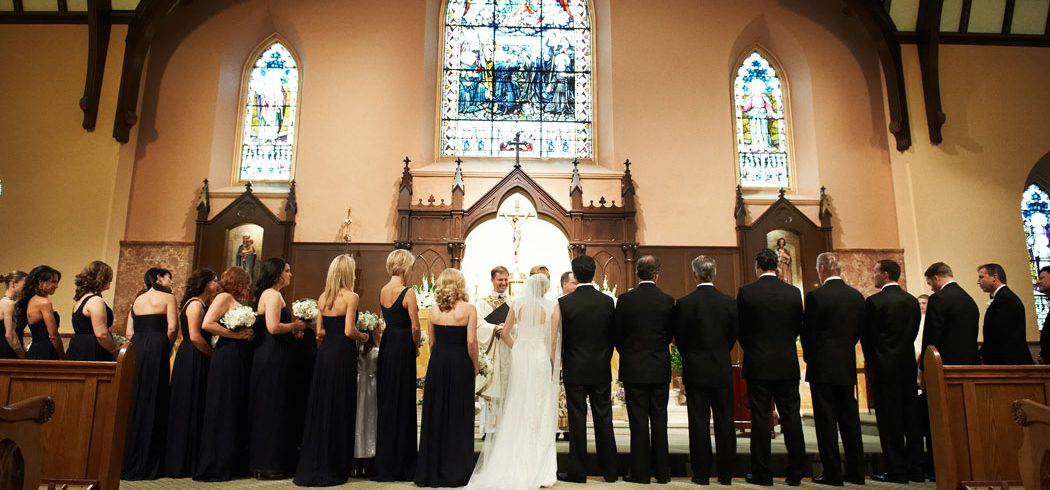 Bridal party at alter during wedding ceremony in Church in Philadelphia, PA - Event Planning