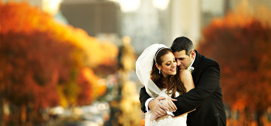 Bride and Groom embrace during outside wedding portraits in Philadelphia, PA - Event Planner