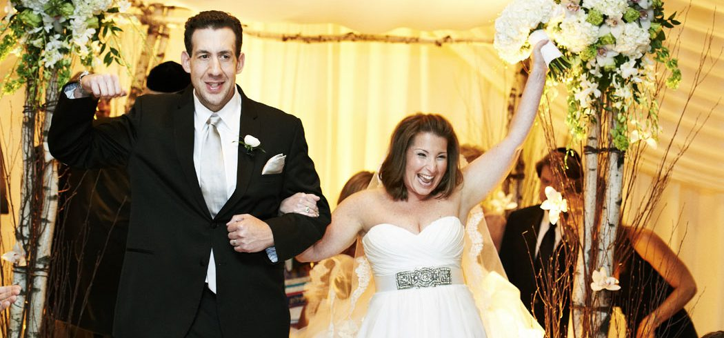Bride and Groom walk down aisle after Jewish wedding ceremony in Philadelphia, PA - Event Planner