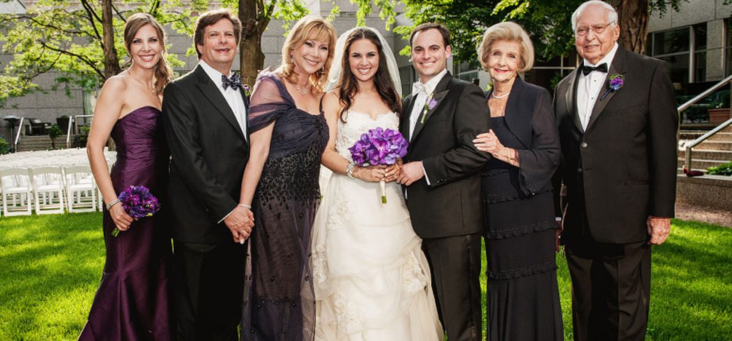 Bride and Groom with Family in Wedding portrait outside in Philadelphia, PA - Event Planning