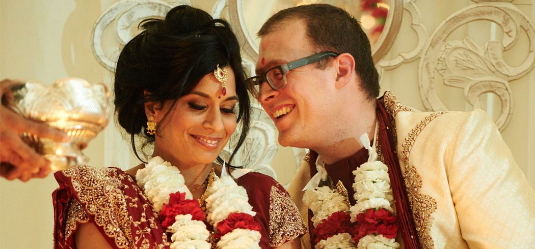 Bride and Groom whisper and laugh during traditional Indian wedding ceremony in Philadelphia, PA - Event Planner