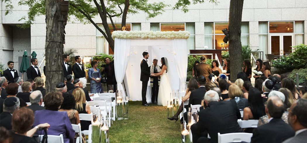 Bride and Groom exchange vows at outdoor Jewish wedding ceremony in Philadelphia, PA - Event Planning
