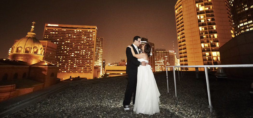 Bride and Groom dance during outside rooftop nighttime wedding portraits in Philadelphia, PA - Event Planner