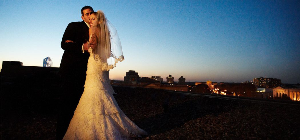 Bride and Groom on rooftop outside nighttime wedding portraits in Philadelphia, PA - Event Planner