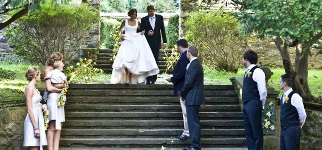 Bride and Father walk down aisle during wedding ceremony in Philadelphia, PA - Event Planner