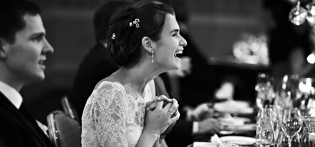 Bride laughing at wedding toast during wedding reception in Philadelphia, PA - Event Planner