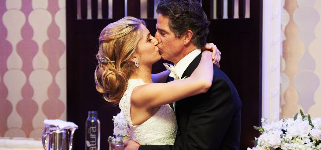 Bride and Groom kiss at wedding reception in Philadelphia, PA - Event Planner