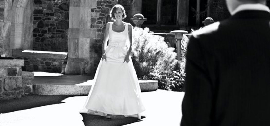 Bride smiling during first look outside wedding portraits in Philadelphia, PA - Event Planner