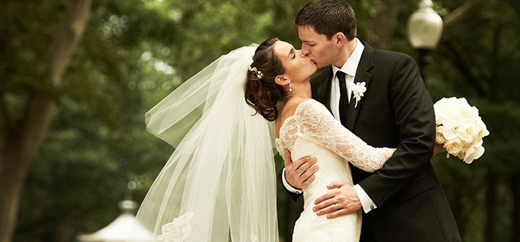 Bride and Groom kiss during outside wedding portraits in Philadelphia, PA - Event Planner