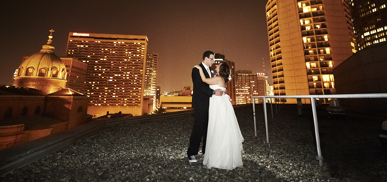Bride and Groom Wedding Portrait embracing on rooftop, Event Planning Philadelphia, PA